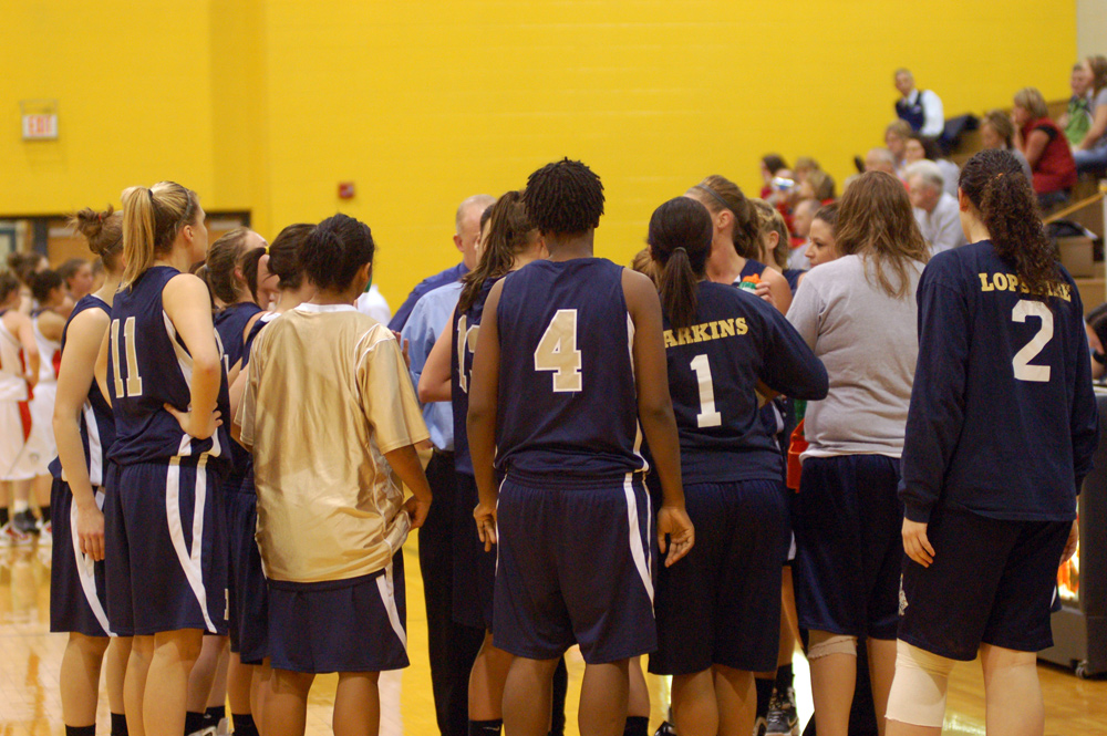 The team huddles during a timeout.
