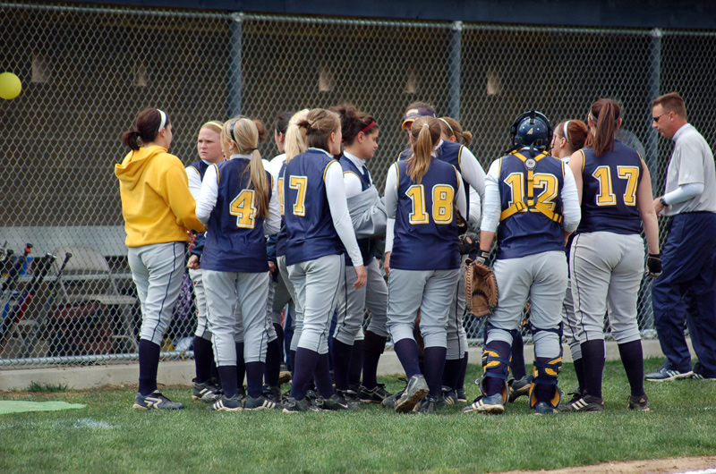 The team huddles after an inning.