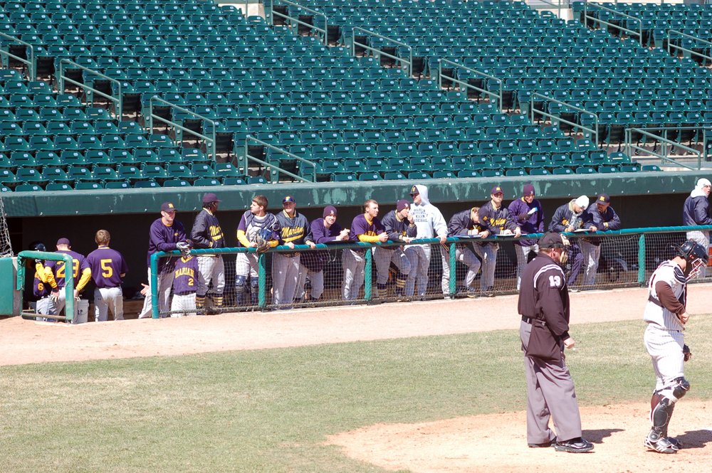 The team in the dugout at Silver Cross Field