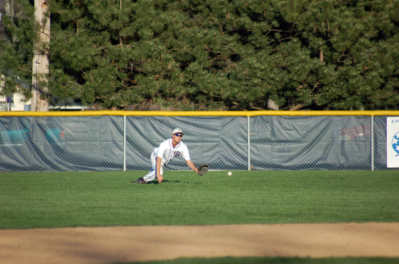 Junior Tony Goodpaster dives for a fly ball.