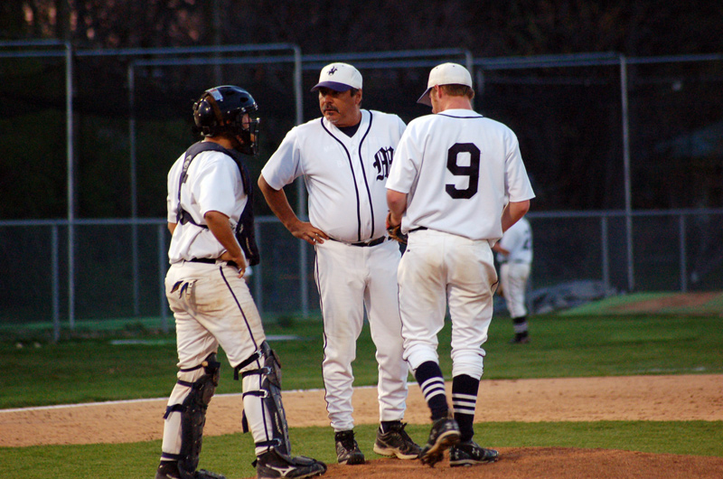 Head coach Kurt Guldner chats with his pitching duo.