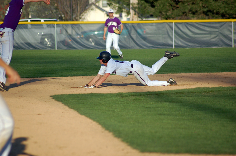 Sophomore Bobby Willis slides safely into second with a stolen base.