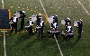 The drumline performs at halftime.