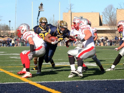 Freshman Tevin Lake scores one of his three touchdowns as MU won its first-ever MSFA Mideast title on Saturday.