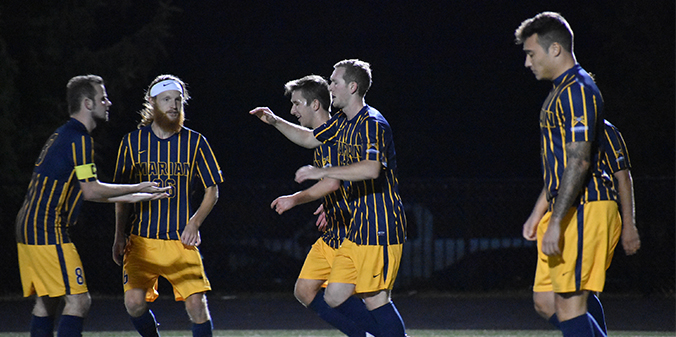 Rhodes' Two Goals Lift Marian To Victory