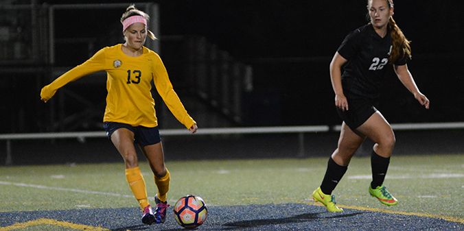 Marian Plays to Draw with Huntington