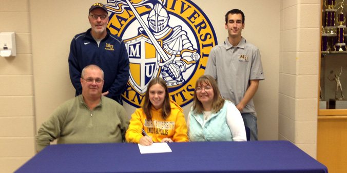Fisher Signs with Coach Holman for 2014-15